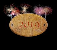 Wooden sign of 2019 with fireworks stock photo