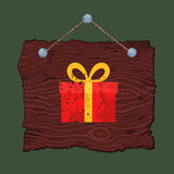 Wooden Sign with Gift. Dark hanging wooden sign with painted Christmas gift Royalty Free Stock Image
