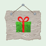 Wooden Sign with Gift. Gray hanging wooden sign with painted Christmas gift Stock Photos