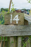 Wooden sign giving garden plot number Royalty Free Stock Images