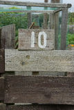 Wooden sign giving garden plot number Royalty Free Stock Image