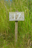Wooden sign giving garden plot number Stock Photo
