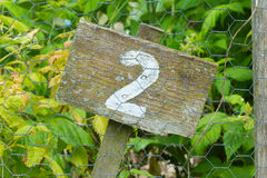Wooden sign giving garden plot number Royalty Free Stock Photo