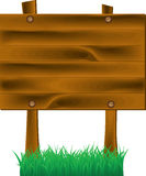 Wooden sign on a grass Stock Photos