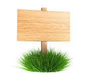 Wooden sign on a grass Stock Photography
