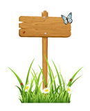 Wooden sign in grass Royalty Free Stock Images