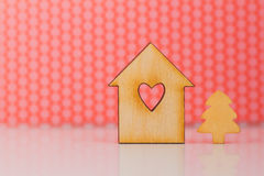 Wooden sign of house with hole in form of heart and little Chris Royalty Free Stock Images
