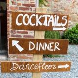 Wooden sign indicates where the wedding stock photos