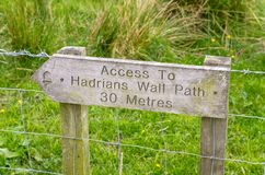 Wooden Sign indicating the Access to a Path Stock Photo