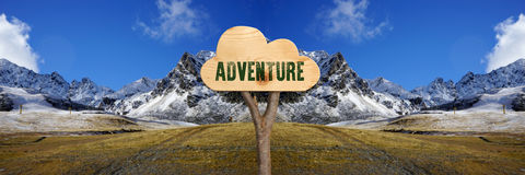 Wooden sign indicating adventure Stock Photos