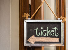 A wooden sign indicating the direction to the ticket Royalty Free Stock Photos