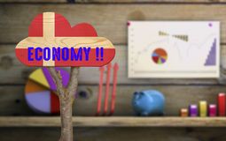 Wooden sign indicating the economy Stock Photography
