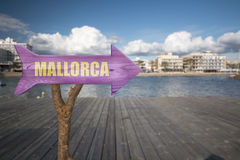 Wooden sign indicating mallorca. Trunk and wooden sign indicating to mallorca Stock Photos