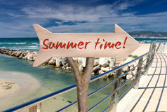 Wooden sign indicating summer time Stock Photography