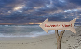 Wooden sign indicating summer time Stock Photo