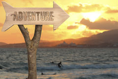 Wooden sign indicating to adventure Stock Photo
