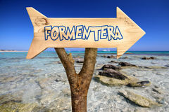 Wooden sign indicating to formentera Royalty Free Stock Image