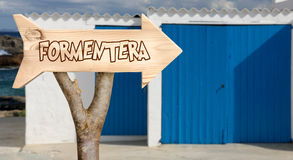 Wooden sign indicating to formentera Stock Photos