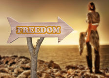 Wooden sign indicating to freedom Royalty Free Stock Image