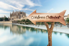 Wooden sign indicating towards Mallorca Cathedral Royalty Free Stock Photo