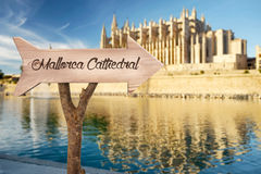 Wooden sign indicating towards Mallorca Cathedral Stock Photos