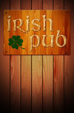Wooden sign IRISH PUB on wooden background Royalty Free Stock Image
