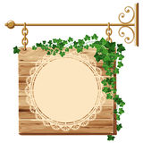 Wooden sign with ivy Stock Image