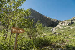 Wooden sign for Lac de Melu in mountains of Corsica Royalty Free Stock Images