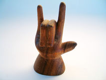 Wooden Sign Language Symbol. A wooden carving of the sign language symbol for I love you stock image