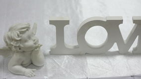 Wooden sign LOVE on table stock video