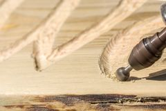 Milling letters in wood with a ball cutter in detail royalty free stock images