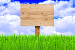 Wooden sign in a meadow Stock Photography