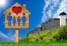 Wooden Sign with Model House Heart and Family royalty free stock photo