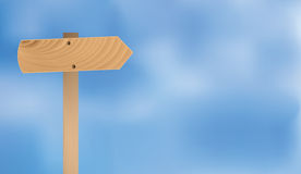 Wooden sign over blue sky Royalty Free Stock Photos