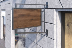 Wooden sign post. Sign post on shop's wall. Concept of advertising and small business development. 3d rendering. Mockup Stock Image