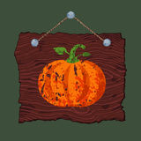 Wooden Sign with Pumpkin. Dark brown hanging wooden sign with painted grunge pumpkin Royalty Free Stock Photography