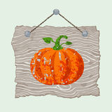 Wooden Sign with Pumpkin. Gray hanging wooden sign with painted grunge pumpkin Royalty Free Stock Image
