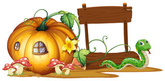 Wooden sign with pumpkin and snake in background Stock Image