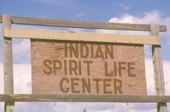 Wooden sign reads Indian Spirit Life Center in Southwestern United States Royalty Free Stock Photo