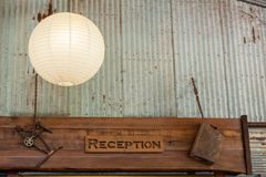 Reception sign decorated with rusty ornaments stock photography