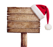Wooden sign with red Santa's hat. Isolated on white Stock Photos