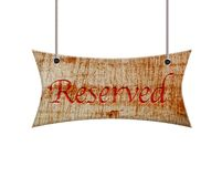 Wooden sign of reserved. Royalty Free Stock Image