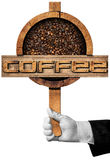 Wooden Sign with Roasted Coffee Beans. Hand of a waiter holding a wooden sign with roasted coffee beans inside and text Coffee. Isolated on white background Royalty Free Stock Image