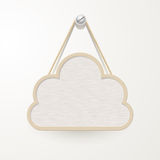 Wooden sign with rope hanging on a nail, cloud design for backgr Stock Photo