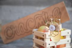 Wooden sign in Russian happiness champagne glass. Wooden sign in Russian happiness with wedding decorated champagne glass and fruits on concrete background Royalty Free Stock Photo