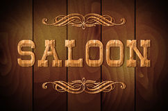 Wooden sign SALOON on a wooden background. Wooden sign SALOON and curly ornaments on a wooden background royalty free illustration