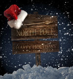 Wooden sign with Santa hat Stock Images