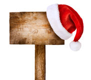 Wooden sign with Santa hat Stock Photo
