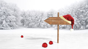 Wooden sign with Santa hat Royalty Free Stock Photography