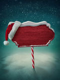 Wooden sign and santa hat Royalty Free Stock Photography